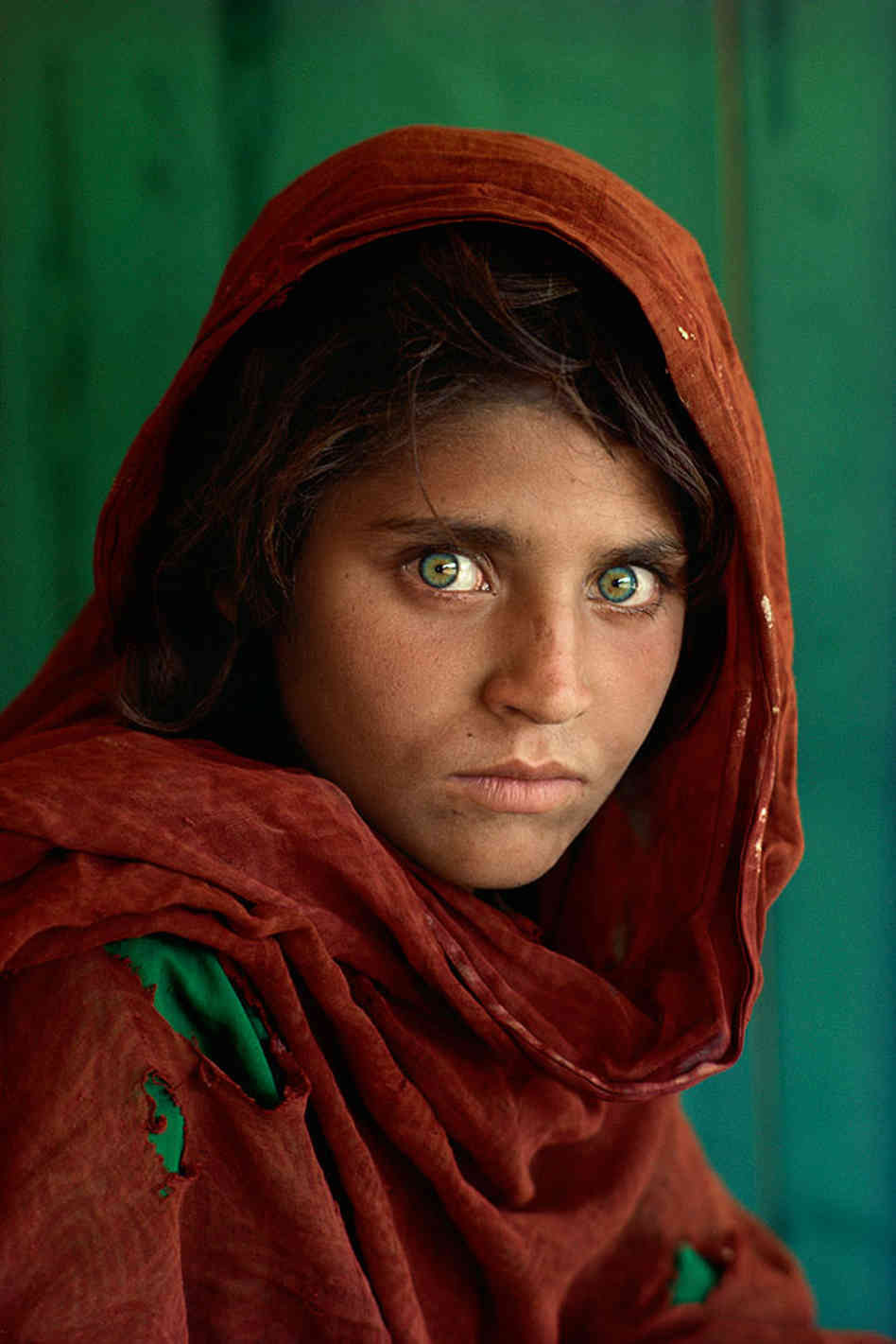 "Magnum photographer Steve McCurry's ""Afghan Girl"""
